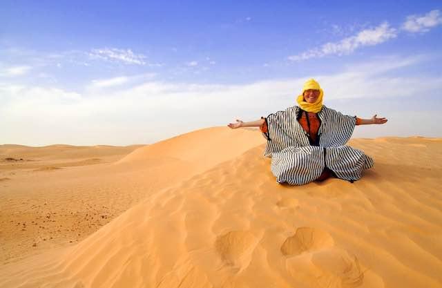 Woman in moroccan desert
